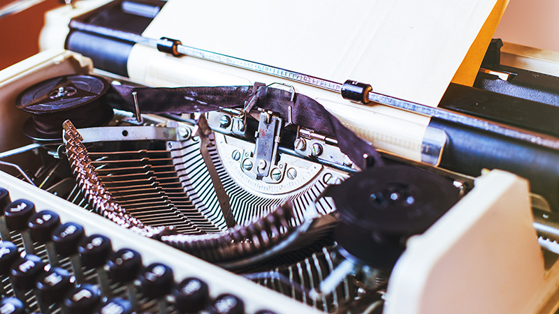 Close up of the keys and typebars of a vintage typewriter